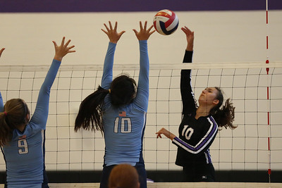 CHS Marie Samek #10 (ight) outside hitter goes high against NCSSM defenders