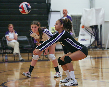 CHS Olivia Meyer-Massey #6 (right) sets ball for teammates. Libero, Anna Broome looks on...