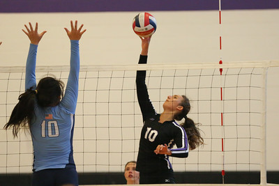 CHS Marie Samek #10 (ight) outside hitter goes high against NCSSM defender