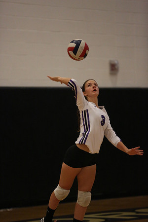 CHS Libero, Anna Broome #3, serves against Northwood