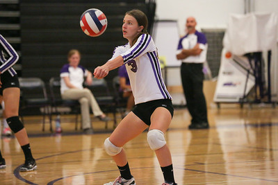 CHS defensive specialist (Libero) Anna Broome #3  sets ball for teammates
