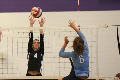 CHS Rachel Frye (#4) blocks spike attempt by NCSSM outside hitter