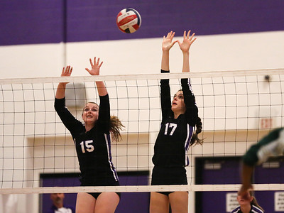CHS middle blocker Fioanna McGuire #17 and setter Anna Tomkins #15 go high for block against Northwood