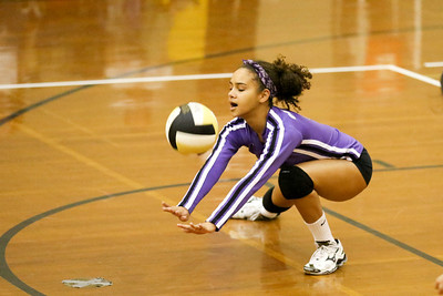 CHS Olivia Meyer-Massey digs out a CHHS spike