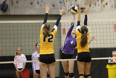 CHS Rachel Frye #4 is challenged at net by CHHS Catherine Romaine #12 and Hannah Blackburn #8