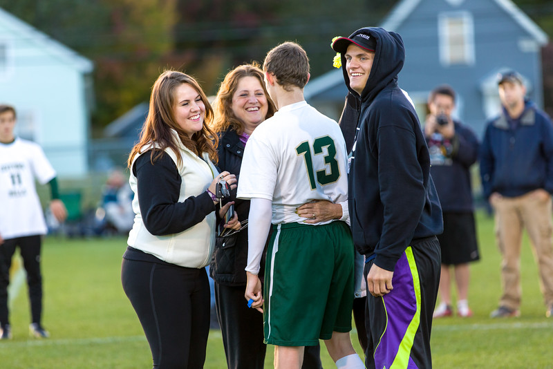 Catching Up: Jordan Chute is greeted by his family during senior game pre-game festivities last fall.  All photos: http://www.brewstersphotos.com/High-School-Sports/20152016/2015-10-10-Oxford-Hills-v-Brewer