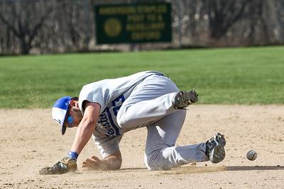 A ground ball gets by Lewiston first baseman Jared Rubin.