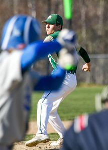 Rearing Back: Oxford Hills' starter and winning pitcher Troy Johnson prepares to deliver a pitch to Lewiston's Eddie Turgeon.