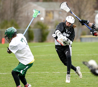 St. Doms Ridge Servido shoots and scores during the first half of his team's game against Oxford Hills at the Gouin Complex in South Paris.