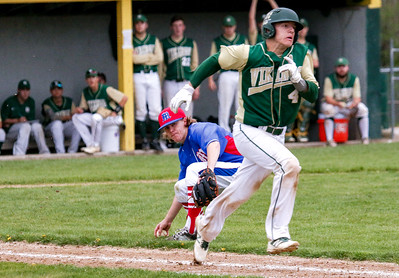 Messalonskee pitcher [name] prepares to throw to first base to get Oxford Hills' Matt Smith out on a successful sacrifice bunt during yesterday's game played at the Gouin Complex in South Paris.