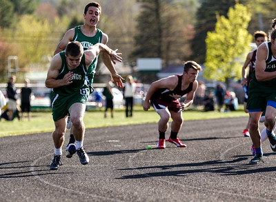 "John Bowen yells ""stick"" to teammate Dawson Stevens as they attemp the handoff on the last leg of the 4 x100 relay during last week's meet at the Gouin Complex."