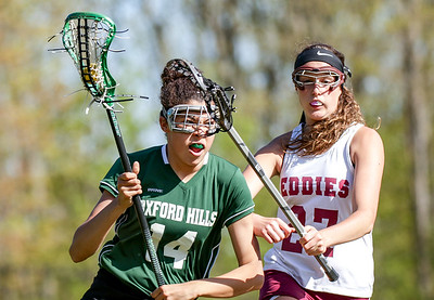 Oxford Hills Jayra Bray moves past Edward Little's Julia Milks during their game played  yesterday at Edward Little High School.