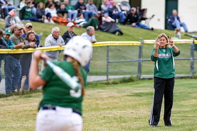 Oxford Hills' head coach Cindy Goddard gives signals to Kenzie Kahkonen in the fifth inning.