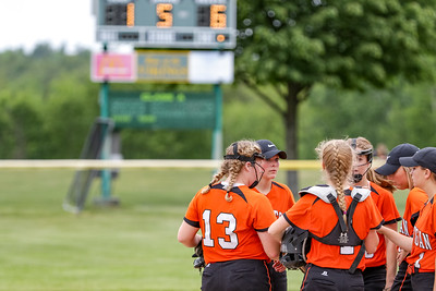 The Skowhegan infield huddles in the fifth inning.