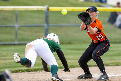 As Skowhegan's Wylie Bedard prepares to catch the ball, Oxford Hills' Hannah Kenney scrambles to get back into third base to beat the throw from Skowhegan catcher Sydney Reed.