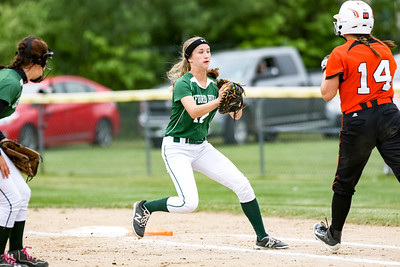 After fielding a ground ball, Oxford Hills' Erin Morton prepares to tag Skowhegan's Lindsey Warren during the second inning.
