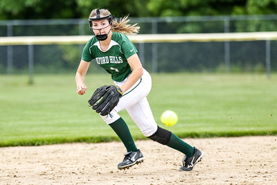 Oxford Hills' Kaisa Heikkinen goes after a ball in the hole during the second inning.