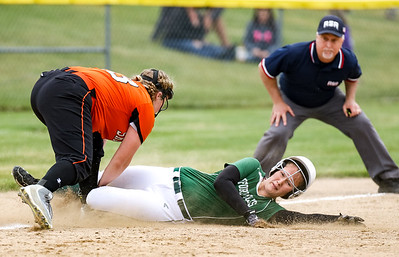 Oxford Hills' Hannah Kenney slides into third base safely as Skowhegan's Bonnie-Jane E. Aiken attempts to make the tag in the second inning.