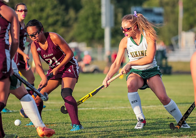 Edward Little's Fournier looks to clear the ball as Oxford Hill's Haley Wakefield looks to stop her  last night at the Gouin Sports Complex in South Paris.