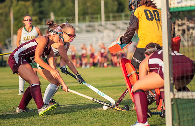 Oxford Hills' Ciara Hamlin reaches for the ball defended by Edward Little's Megan Steele.  Backing up goalie Emily Lashua is teammate Jaylyn Metivier last night at the Gouin Sports Complex in South Paris.