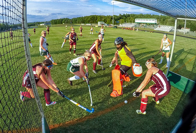 Mad Scramble: Guarded by Edward Little's Jaylyn Metivier, Oxford Hill's Ciara Hamlin gets the ball by goalie Emily Lashua and defender Tyme Finnerty to score tonight at the Gouin Sports Complex in South Paris.