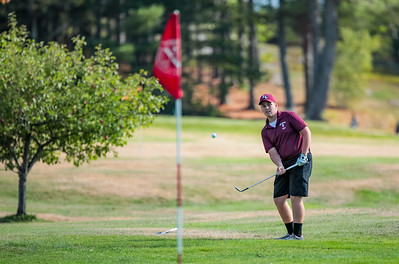 Edward Little's Ryan Raby watches his pitch on the second hole at Norway Country Club during his match with Oxford Hills.