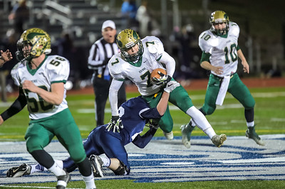 Portland's Jake Knop  trips up Oxford Hills' Ryland VanDecker in the backfield early in the game last night at Fitzpatrick Stadium in Portland.