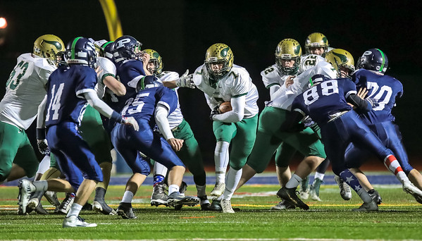 Oxford Hills' Ryland VanDecker gains a few yards in a run early in the game last night at Fitzpatrick Stadium in Portland.