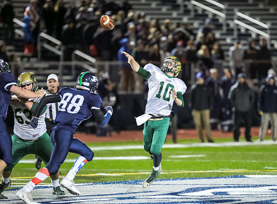 Oxford Hills' Connor Truman lats a desperation pass go during last night's game at Fitzpatrick Stadium in Portland.