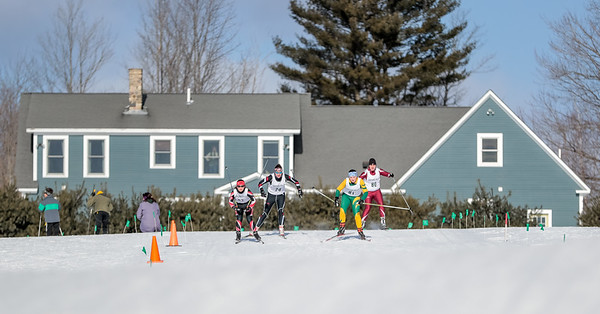 Left to right, Gwinna Remillard of Central Maine Ski Club, Emily Grenier of St. Doms, Olivia Swift of Oxford Hills, and Time Finnerty of Edward Little look for position early on in their time trial.