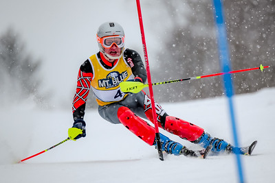 Winthrop's Charlie DeHass carves a left-footer at the top of the headwall at the KVAC/MCA Championships at Ticomb Mountain in Farmington yesterday.