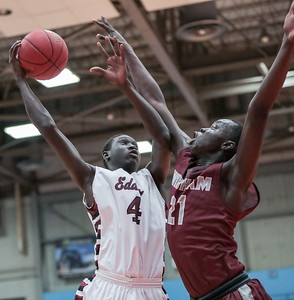 Edward Little's Wol Maiwen-Diing attempts to go to the basket guarded by Windham's Dierhow Bol.