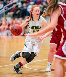 Oxford Hills' Julia Colby drives to the basket.