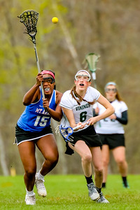 Oxford Hills' Caroline Burns and Mt. Ararat's Magan Thomas-Copland battle for the ball after a face-off in the 3rd quarter of yesterday's game at the Gouin Complex in South Paris.