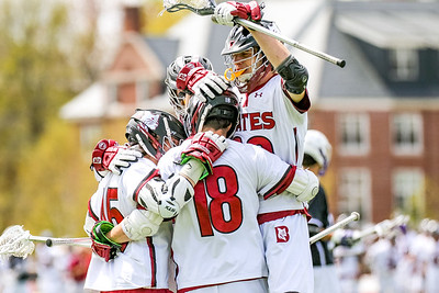 Bates player come together to celebrate a goal in the third quarter.
