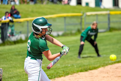 Oxford Hills' pitcher Madi Day hits a triple yesterday at the Gouin Complex in South Paris.