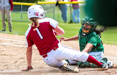 Oxford Hills' Anna Piirainen puts the tag on Bangor's Lexi Cunningham yesterday at the Gouin Complex in South Paris.