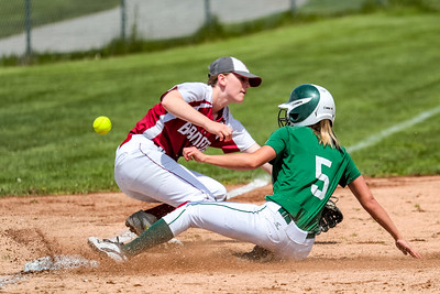 The ball gets by Bangor third baseman Megan Conner allowing Oxford Hills' Makayla Starbird to score yesterday at the Gouin Complex in South Paris.