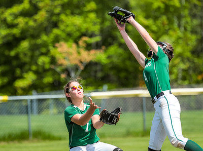 Oxford Hlls' left fielder Madi Day backs up teammate Kaisa Heikkinen yesterday at the Gouin Complex in South Paris.
