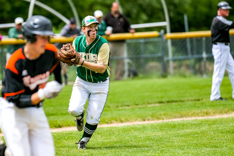 Oxford Hills' third basemen Emery Chickering prepares to throw to first after fielding a bunt in the game yesterday at the Gouin Comples in South Paris.