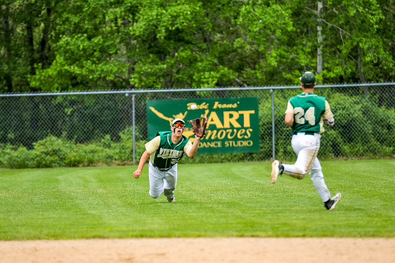Oxford Hills' left fielder Hunter LaBossiere dives and catches a ball midway through the game yesterday at the Gouin Complex in South Paris.