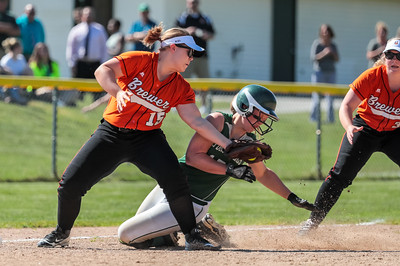 Oxford Hills Hannah Kenney gets tagged out by Brewer third baseman Crystal Dore during the third inning of yesterday's game at the Gouin Complex in South Paris.