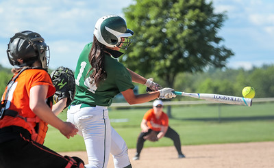Oxford Hills Anna Piirainen drives the ball the left field during the fourth inning of yesterday's game at the Gouin Complex in South Paris.