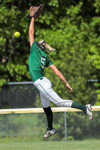 Oxford Hills' Madison Starbird leaps for a line drive early in the game.