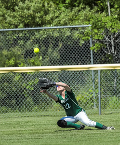 Ofrod Hills right fielder struggles with a fly ball hit into the sun during the second inning of yesterday's game at the Gouin Complex in South Paris.