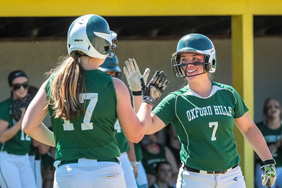 Oxford Hills' Hannah Kenney gets congratulated by teammate Madi Day after scoring in the second inning.