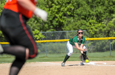 Oxford Hills first baseman Erin Morton catches a low throw from teammate Anna Piirainen to record the final out of the second inning during yesterday's game at the Gouin Complex in South Paris.