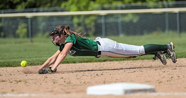 Oxford Hills shortstop Kaisa Heikkinen just misses a ground ball in the hole.