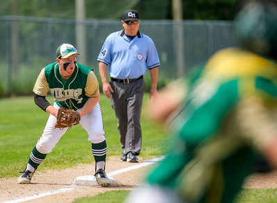 Oxford Hills' Emery Chickering gets ready to throw out the baserunner after fielding a ground ball on the third base line.