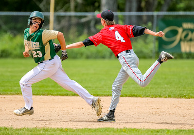Oxford Hills' Hunter LaBossiere gets tagged out by Camden's True Crane in a rundown for the third out of the inning midway theough the game.